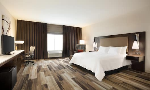 King Bed in Accessible Room with HDTV and Work Desk