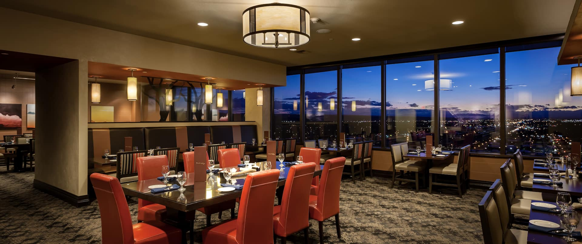 Restaurant Dining Tables and Large Windows With Sunset View