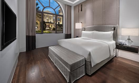 Guest Room with large Bed HDTV and Bay Window