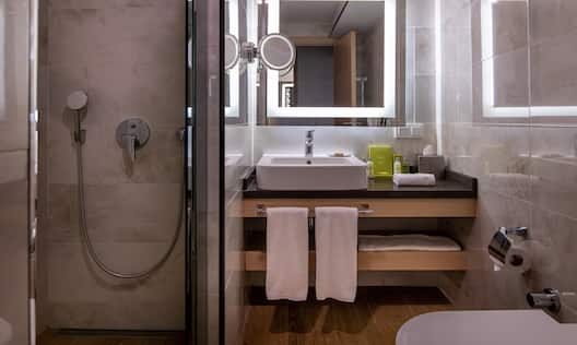 Bathroom with sink, mirror and shower