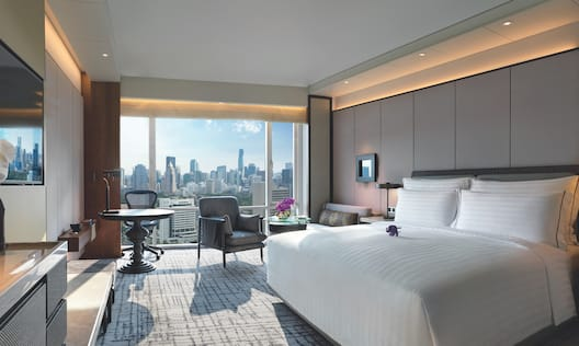 Premium Guest Room Bed, Desk and Large Window