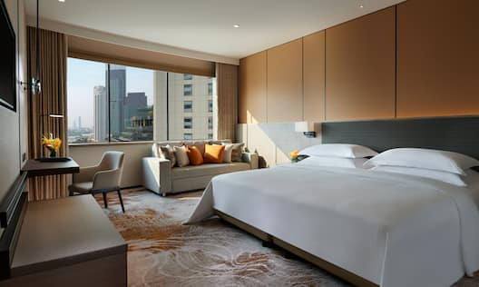 King Bed in Family Room with View of City