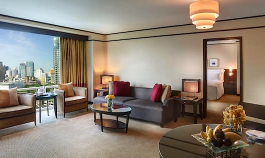 Living area with couch, tables and chairs