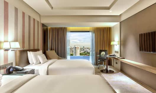 These spacious rooms include welcome drink, extra amenities & Sweet Dreams® signature twin beds