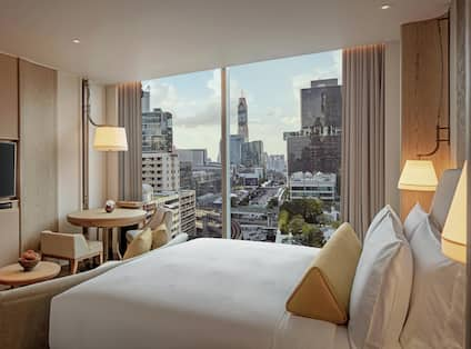 King Bed, Flat Screen TV, and City View in Deluxe Guest Room