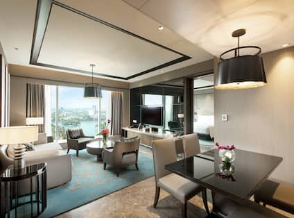 Executive Suite Lounge Area with Sofa, Chairs and Tables