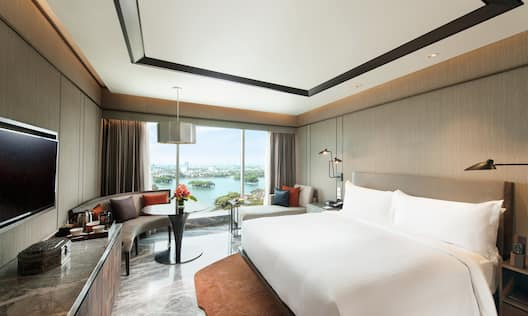 Executive Guestroom with Bed, Lounge Area, Outside View, and Room Technology