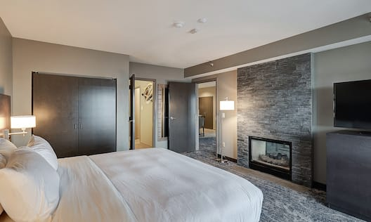 Presidential Suite Bedroom with Bed and Room Technology
