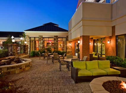 Large outdoor patio with comfortable seating and firepit