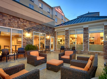 View of Outdoor Patio Area with Soft Seats in the Evening