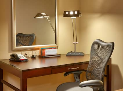 Desk Area with Lamp and Mirror in Guest Room