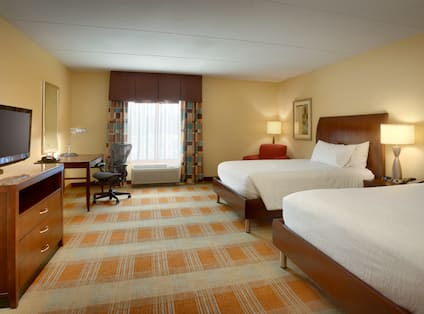 Room with Desk TV and Two Beds