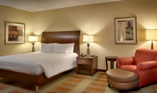 Guest Bedroom with a King sized Bed and Soft Chair