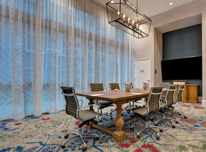 boardroom with table seating and television