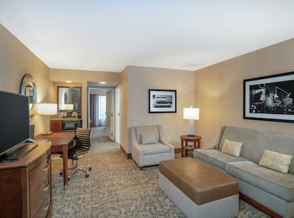 Suite Living Area with Sofa Chair TV and Desk