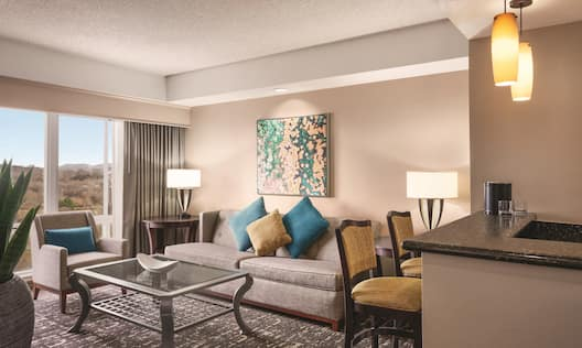 Suite area with comfortable seating and table