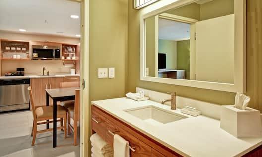Bathroom Vanity and Kitchen Area in Suite