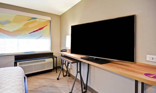 Guest Room with Work Desk and Television
