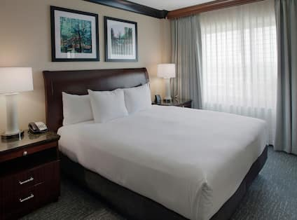 a king bed in a hotel bedroom