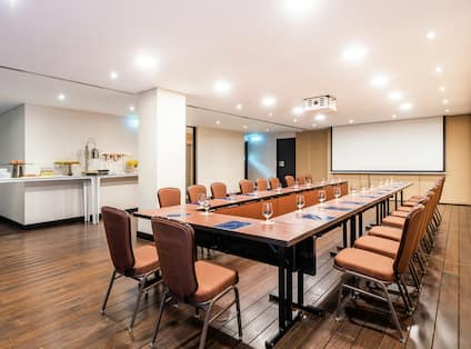 U Set Up Meeting Room with Seating for 20 Guests