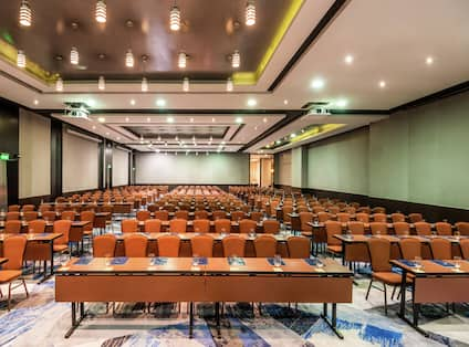 Large meeting room with tables and chairs