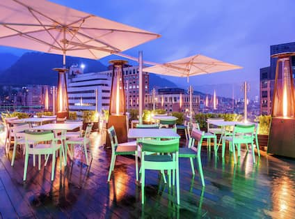 Sky 15 Rooftop Bar with outdooor tables and chairs