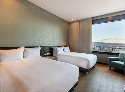 Guest Room with Two Double Beds and City View