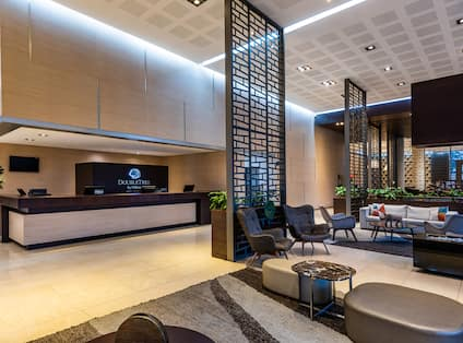 DoubleTree Hotel Reception Desk and Lobby Seating Area with HDTV