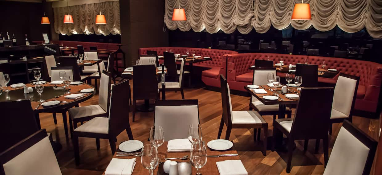 Table and Booth Seating Options in Restaurant Dining Area - Agata