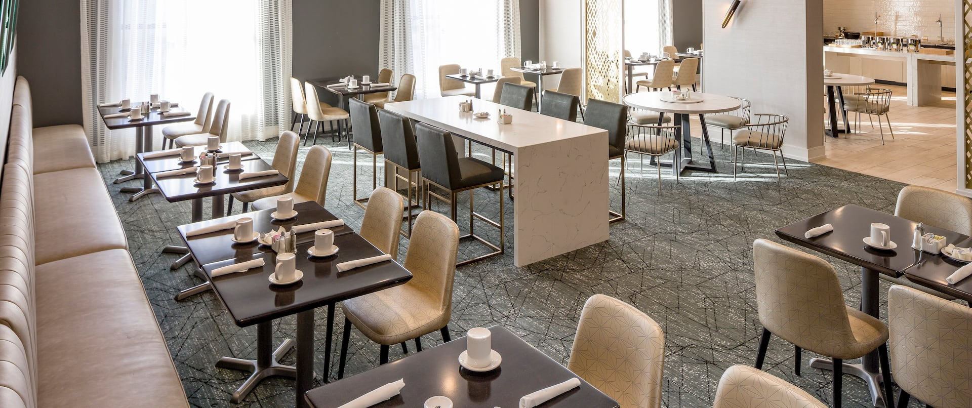 Restaurant Dining Area with Chairs, Tables and Sofa Seating