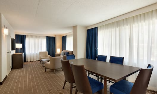 Executive Suite Living Area with Meeting Table and Chairs