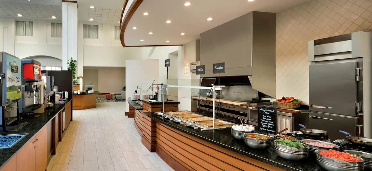 Complimentary Breakfast Area with Food Selections