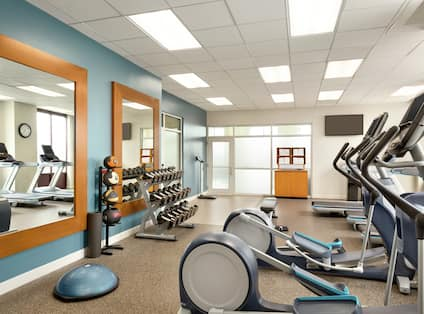 Fitness Center with Treadmills Recumbent Bikes and Weights Area