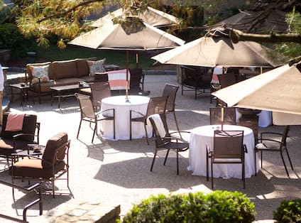 Outdoor Seating Area Round Tables Charis Umbrellas