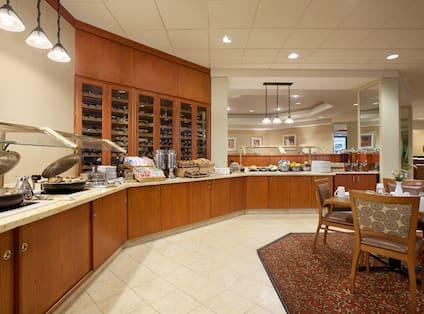 Hot and Cold Buffet Selections and Dining Table in SORA Restaurant