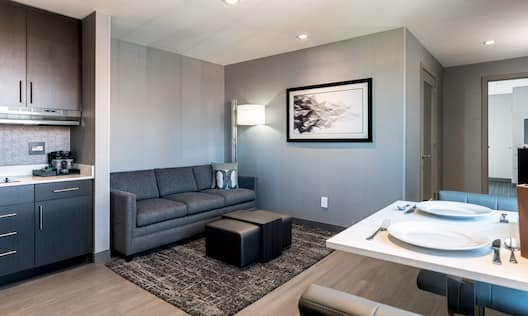 Accessible Suite Living Room with chairs, table and plates