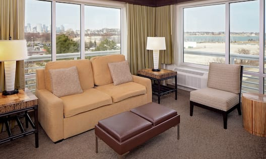 King Suite Living Space with Water and City Views