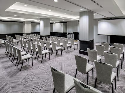Kellogg Meeting Room with Two Projection Screens Setup Theater Style