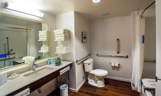 Accessible Guest Bathroom with Vanity, Toilet and Bath Tub