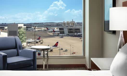 King Bed Hotel Guestroom With Airport View