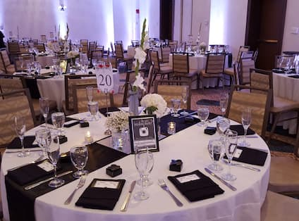 A large white table with place settings