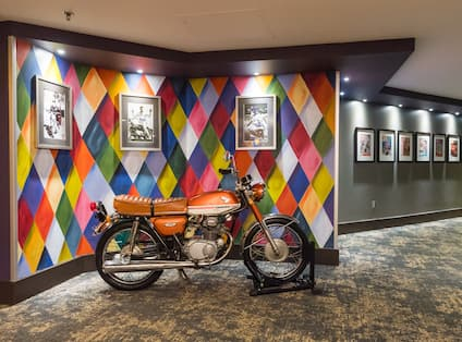 Motorcyle in lobby with artwork