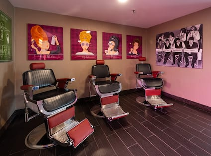 Hairdressers' seats with artwork