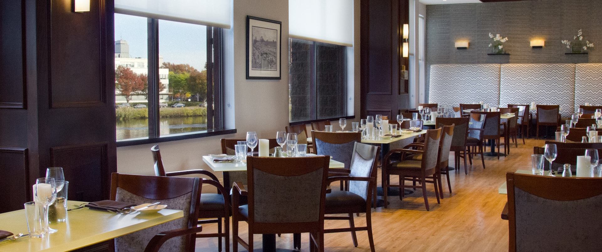 Table and Booth Seating Near Windows With Outside Views in Dining Area of Boathouse 400 Restaurant