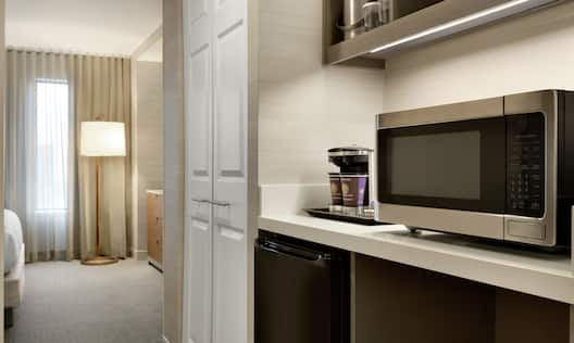 Hospitality Center With Coffee Maker, Mini-Fridge, and Microwave in Suite