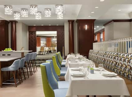Grille at Hobbs Brook with Round Tables and Chairs