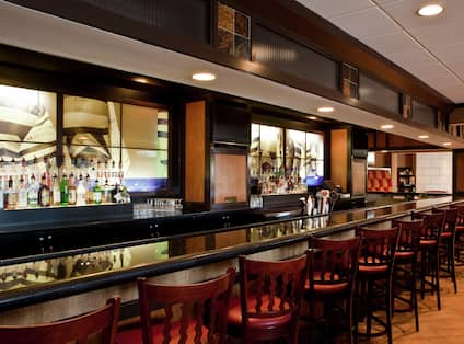 Fully Stocked Bar at Regatta Lounge With Counter Seating