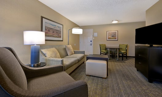 guest room lounge area with television and entry way