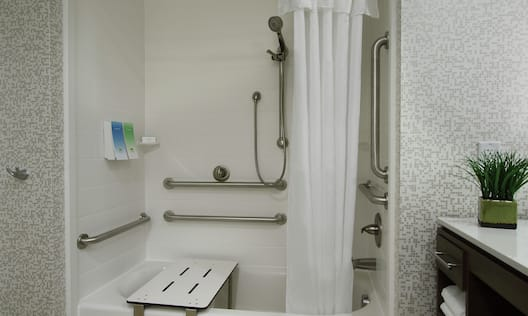 Accessible Guest Bathroom with Tub and Bench Seat