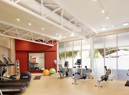 Fitness Centre With Cardio Equipment, Weight Balls, Large Mirror, Stability Balls, and Window With Outside View